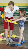 Coach Jo Shows Little Girl How to Hold Boogie Board