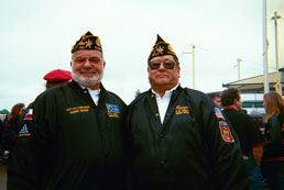 Two veterans smiling into camera