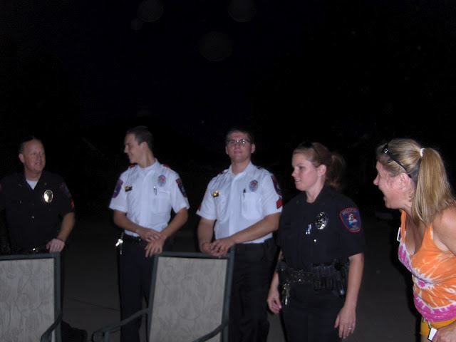 Four uniformed officers socializing during National Night Out